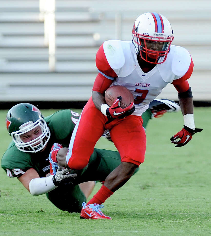 Skyline's Ellis Onic runs upfield past The Woodlands Tanner Birdsong (49) in the first quarter during a Class 5A high school football game, Saturday, Sept. 31, 2012 at FC Dallas Stadium in Frisco, Texas. Photo: Matt Strasen, Special Contributor / Matt Strasen