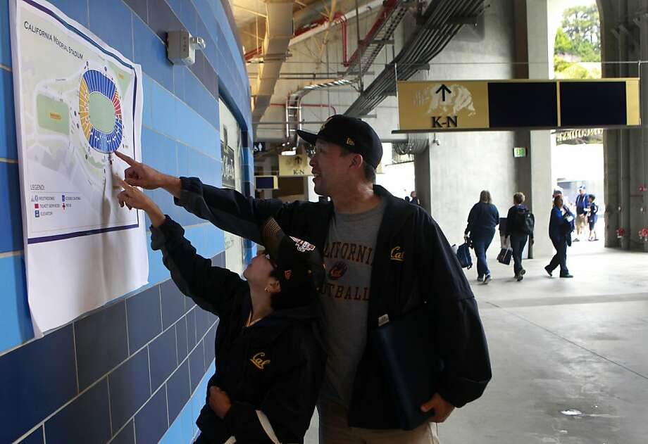 Wayne Takata and his wife Wendy Adachi try to locate their seats at the renovated Memorial Stadium before the Cal Bears football game against the Nevada Wolfpack in Berkeley, Calif. on Saturday, Sept. 1, 2012. Photo: Paul Chinn, The Chronicle