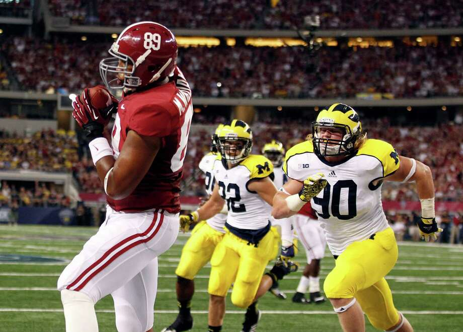 Alabama tight end Michael Williams (89) pulls in a touchdown pass in front of Michigan linebacker Jake Ryan (90) and safety Jordan Kovacs (32) during the first half of an NCAA college football game at Cowboys Stadium in Arlington, Texas, Saturday, Sept. 1, 2012.  (AP Photo/LM Otero) Photo: LM Otero, Associated Press / AP
