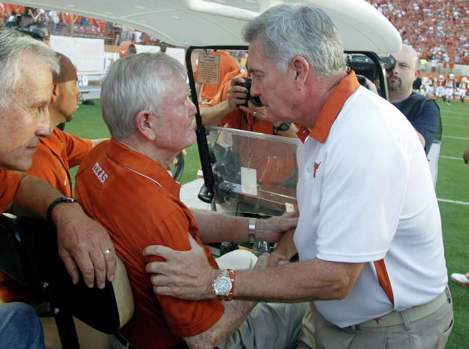 Texas coach Mack Brown, right, greets former head coach Darrell Royal befor the start of an NCAA college football game against Wyoming, Saturday, Sept. 1, 2012, in Austin, Texas.(AP Photo/Jack Plunkett) Photo: JACK PLUNKETT / FR59553 AP