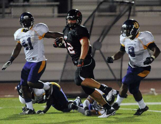 UIW fullback Matt Bass runs for yardage during second-half action against Texas College at Benson Stadium on Saturday, Sept. 1, 2012. Photo: Billy Calzada, Express-News / © San Antonio Express-News