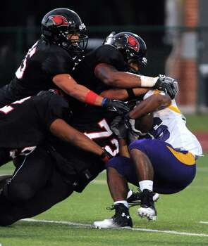 Texas College running back Eric Moore is gang tackled by the Incarnate Word defense during college football action at Benson Stadium on Saturday, Sept. 1, 2012. Photo: Billy Calzada, Express-News / © San Antonio Express-News