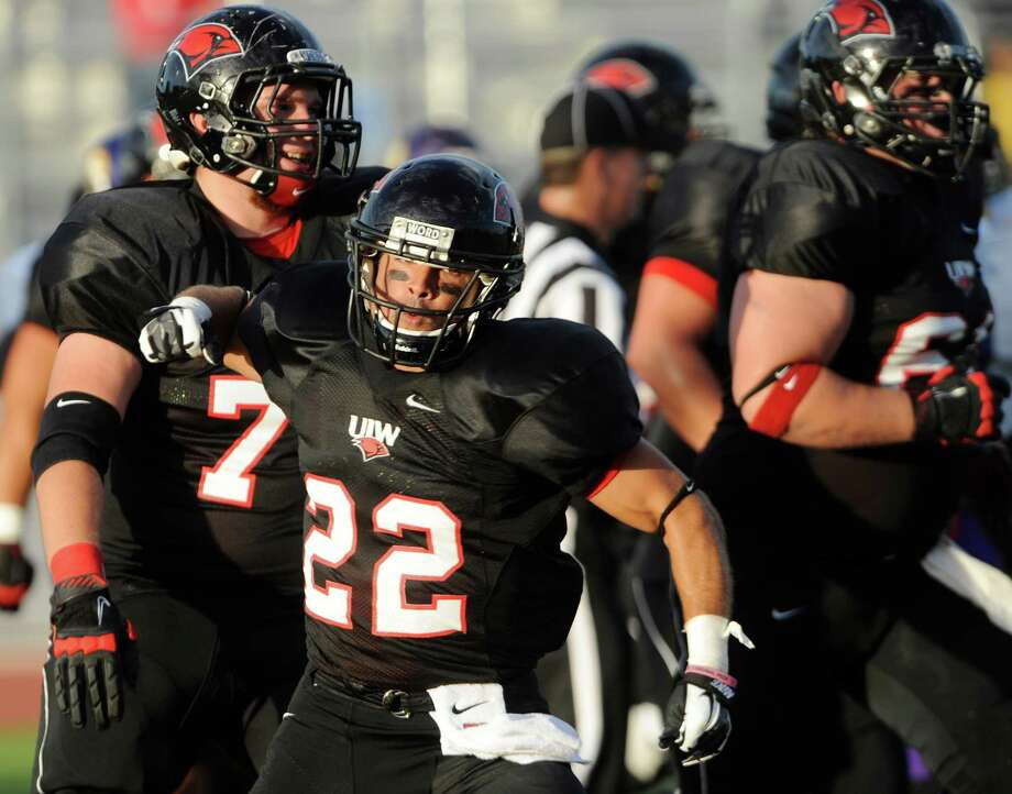 Running back Trent Rios of Incarnate Word celebrates after scoring a first-half touchdown against Texas College during football action at Benson Stadium on Saturday, Sept. 1, 2012. Photo: Billy Calzada, Express-News / © San Antonio Express-News