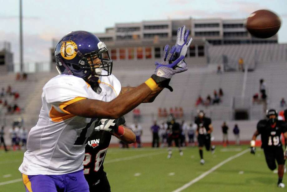 Jamaal Johnson of Texas College hauls in a pass as Kielyn Lewis of Incarnate Word chases during college football action at Benson Stadium on Saturday, Sept. 1, 2012. Photo: Billy Calzada, Express-News / © San Antonio Express-News