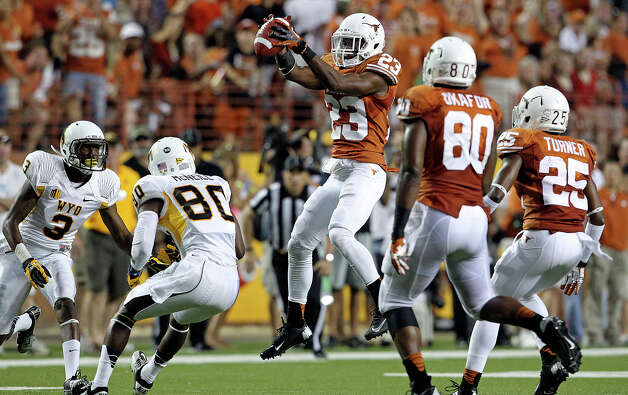 Longhorn defensive back Carrington Byndom comes down with an interception as Texas hosts Wyoming at D.K.Royal Stadium in Austin on September 1, 2012. Photo: Tom Reel, Express-News / ©2012 San Antono Express-News
