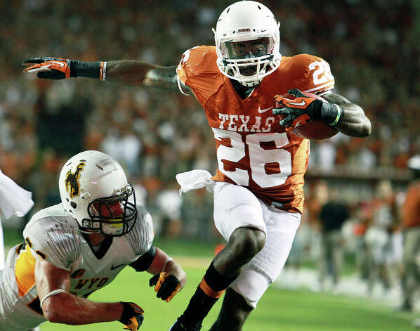 D.J. Monroe high steps to the goal line for a second quarter touchdown as Texas hosts Wyoming at D.K.Royal Stadium in Austin on September 1, 2012. Photo: Tom Reel, Express-News / ©2012 San Antono Express-News