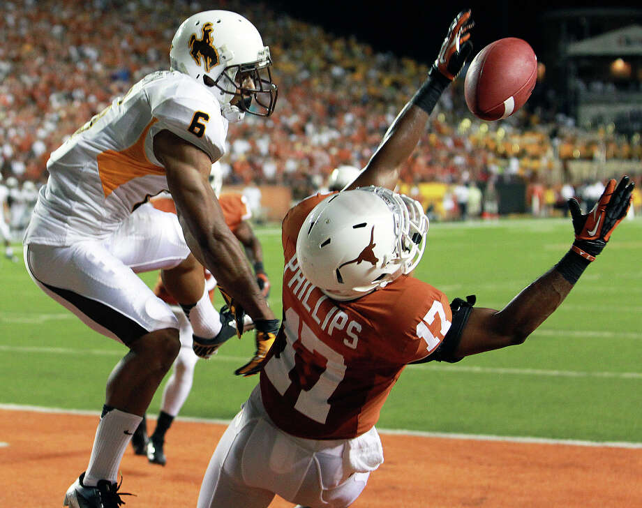Longhorn defender Adrian Philips breaks up a pass to Robert Herron and almost gets the interception  in the fourth quarter as Texas hosts Wyoming at D.K.Royal Stadium in Austin on September 1, 2012. Photo: Tom Reel, Express-News / ©2012 San Antono Express-News