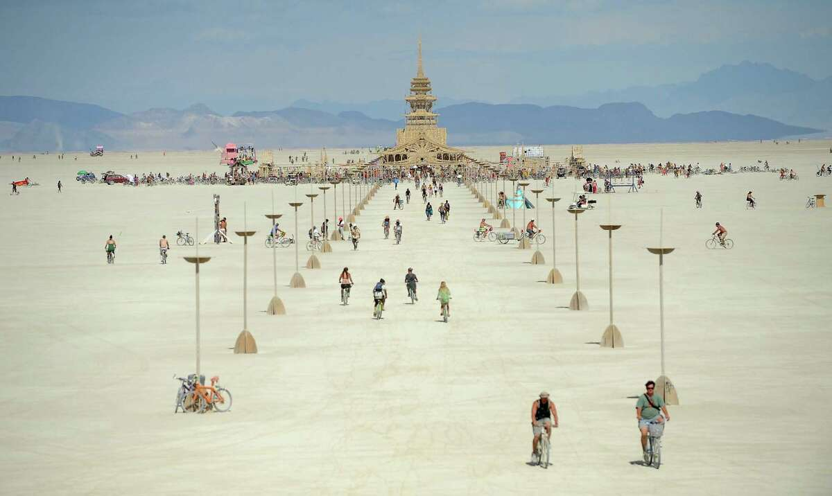 People walk toward the temple at Burning Man near Gerlach, Nev., on the Black Rock Desert on Friday, Aug. 31, 2012.