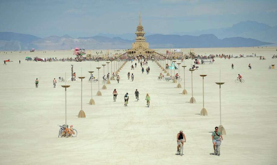 People walk toward the temple at Burning Man near Gerlach, Nev., on the Black Rock Desert on Friday, Aug. 31, 2012. Photo: AP