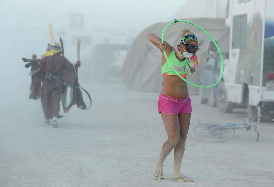Stephanie King of Little Rock, Ark., hula hoops to the music of a band playing near her on Tuesday. Photo: AP