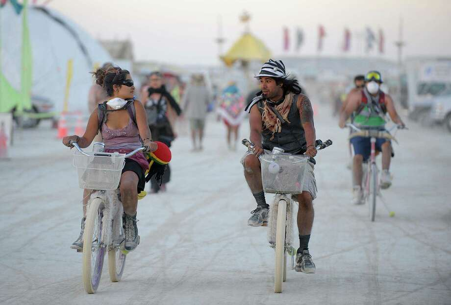 Burners ride their bicycle through the streets on Tuesday. Photo: AP