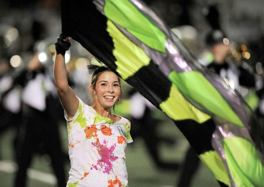 A member of the Reagan color guard performs during half time of a high school football game against Wagner, Saturday, Sept. 1, 2012, at Comalander Stadium in San Antonio. Photo: Darren Abate, Express-News