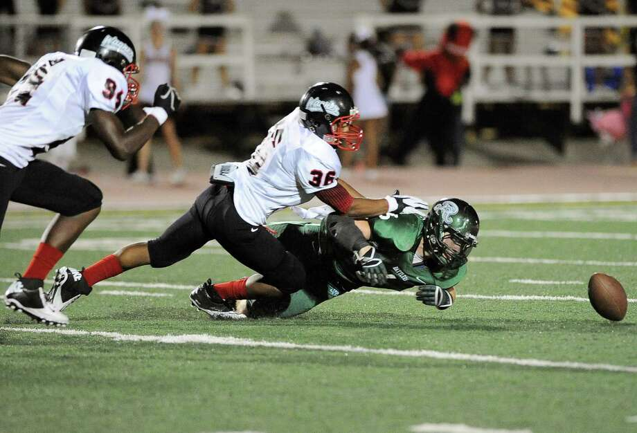 Reagan's Jake Perez (6) scrambles for the ball ahead of Wagner's Marques Blue (36) and Marquise Braziel after it was touched by Perez on the punt reception during the second half of a high school football game, Saturday, Sept. 1, 2012, at Comalander Stadium in San Antonio. Photo: Darren Abate, Express-News