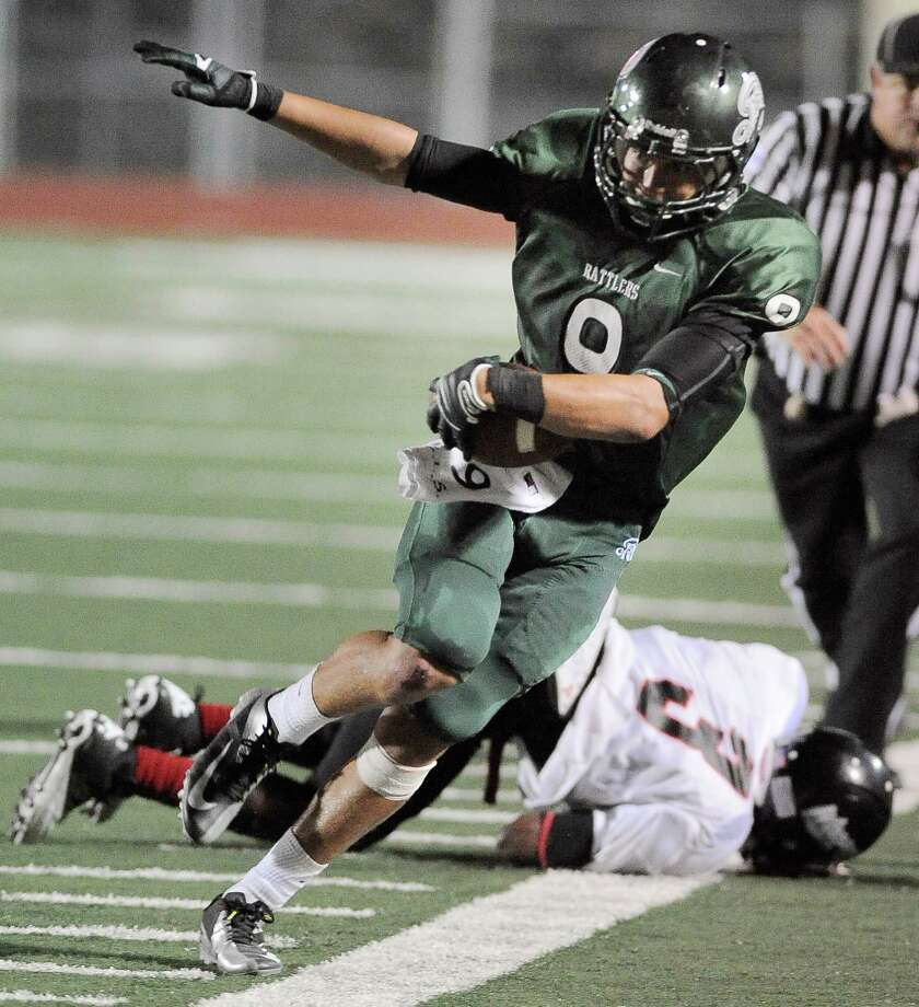Reagan's Kash Knutson (9) evades Wagner's DeAnthony Lee for a reception in the second half of a high school football game, Saturday, Sept. 1, 2012, at Comalander Stadium in San Antonio. Photo: Darren Abate, Express-News