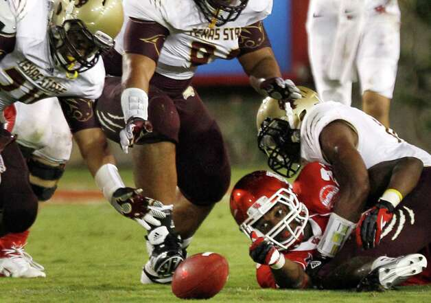 Texas State linebacker Brian Lilly (34) dives on a fumble by Houston wide receiver Daniel Spencer (27) for a turnover during the second quarter in an NCAA football game at Robertson Stadium, Saturday, Sept. 1, 2012, in Houston. Photo: Brett Coomer, Houston Chronicle / © 2012  Houston Chronicle
