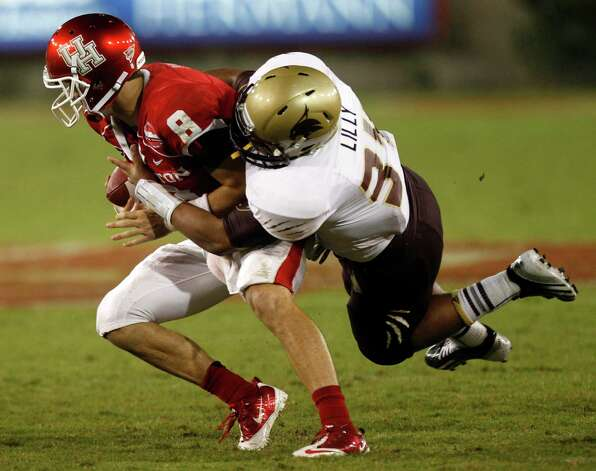Texas State linebacker Brian Lilly (34) sacks Houston quarterback David Piland (8) during the fourth quarter in an NCAA football game at Robertson Stadium, Saturday, Sept. 1, 2012, in Houston. Texas State beat Houston 30-13. Photo: Brett Coomer, Houston Chronicle / © 2012  Houston Chronicle