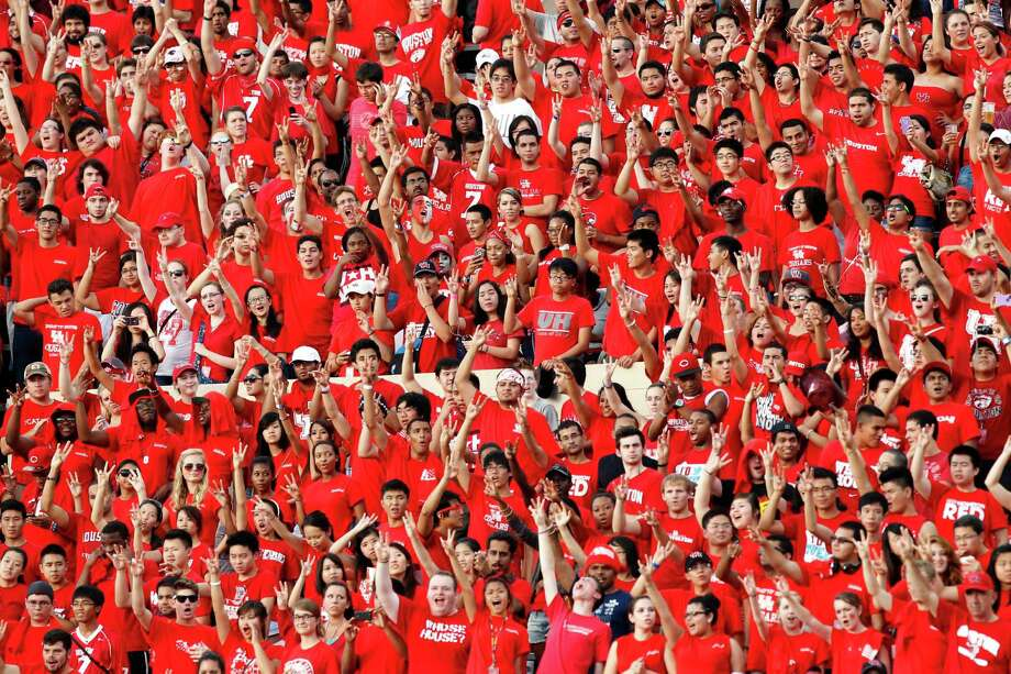 Houston fans cheer during the first quarter in an NCAA football game against Texas State at Robertson Stadium, Saturday, Sept. 1, 2012, in Houston. Photo: Brett Coomer, Houston Chronicle / © 2012  Houston Chronicle