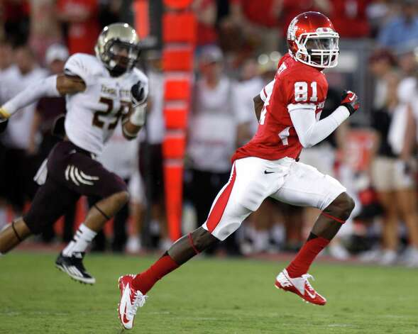 Houston wide receiver Larry McDuffey (81) runs past Texas State cornerback Craig Mager (25) on his way to a 64-yard touchdown reception during the first quarter in an NCAA football game at Robertson Stadium, Saturday, Sept. 1, 2012, in Houston. Photo: Brett Coomer, Houston Chronicle / © 2012  Houston Chronicle