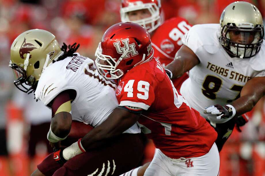 Houston linebacker Derrick Mathews (49) sacks Texas State quarterback Shaun Rutherford (17) during the first quarter in an NCAA football game at Robertson Stadium, Saturday, Sept. 1, 2012, in Houston. Photo: Brett Coomer, Houston Chronicle / © 2012  Houston Chronicle