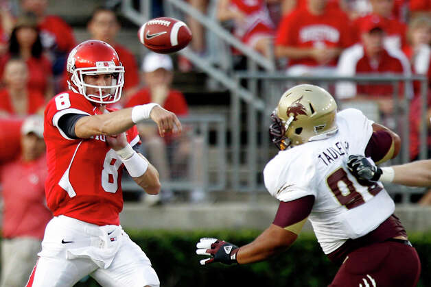 Houston quarterback David Piland (8) throws a pass over Texas State defensive lineman Kamu Taulelei (98) during the first quarter in an NCAA football game at Robertson Stadium, Saturday, Sept. 1, 2012, in Houston. Photo: Brett Coomer, Houston Chronicle / © 2012  Houston Chronicle