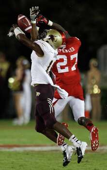 Texas State safety Xavier Daniels (18) breaks up a pass intended for Houston wide receiver Daniel Spencer (27) during the second quarter in an NCAA football game at Robertson Stadium, Saturday, Sept. 1, 2012, in Houston. Photo: Brett Coomer, Houston Chronicle / © 2012  Houston Chronicle