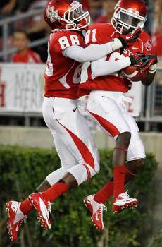Houston wide receivers Xavier Maxwell (88) and Larry McDuffey (81) celebrate McDuffey's 64-yard touchdown reception against Texas State during the first quarter in an NCAA football game at Robertson Stadium, Saturday, Sept. 1, 2012, in Houston. Photo: Brett Coomer, Houston Chronicle / © 2012  Houston Chronicle