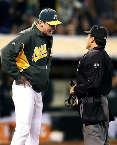 Oakland Athletics manager Bob Melvin, left, argues a call with home plate umpire Phil Cuzzi in the sixth inning against the Boston Red Sox in a baseball game Saturday,  Sept. 1, 2012 in Oakland, Calif. (AP Photo/Tony Avelar) Photo: Tony Avelar, Associated Press
