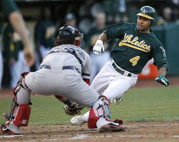 Oakland Athletics' Coco Crisp (4) is tagged out at home plate by Boston Red Sox catcher Jarrod Saltalamacchia (39) in the third inning of a baseball game Saturday,  Sept. 1, 2012 in Oakland, Calif. (AP Photo/ Tony Avelar) Photo: Tony Avelar, Associated Press