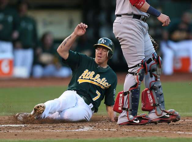 Brandon Inge #7 of the Oakland Athletics slides home safe on a Johny Gomes single in the 3rd inning against the Boston Red Sox during a Major League Baseball game at the O.co Coliseum on September 1, 2012 in Oakland, California.  (Photo by Jed Jacobsohn/Getty Images) Photo: Jed Jacobsohn, Getty Images