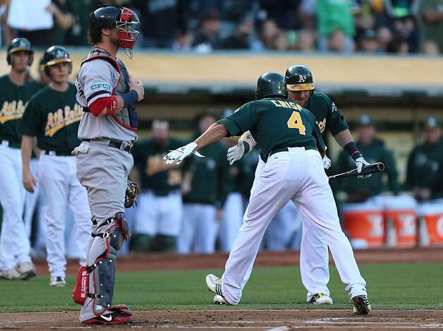 Coco Crisp #4 of the Oakland Athletics celebrates with teammate Jonny Gomes #31 after hitting a lead off home run against the Boston Red Sox during a Major League Baseball game at the O.co Coliseum on September 1, 2012 in Oakland, California.  (Photo by Jed Jacobsohn/Getty Images) Photo: Jed Jacobsohn, Getty Images