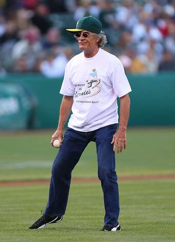 Actor Terry Kiser throws out the first pitch of the Boston Red Sox against the Oakland Athletics Major League Baseball game at the O.co Coliseum on September 1, 2012 in Oakland, California. (Photo by Jed Jacobsohn/Getty Images) Photo: Jed Jacobsohn, Getty Images