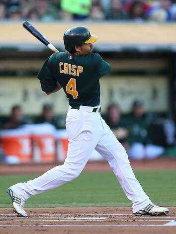 OAKLAND, CA - SEPTEMBER 01:  Coco Crisp #4 of the Oakland Athletics hits a lead off home run against the Boston Red Sox during a Major League Baseball game at the O.co Coliseum on September 1, 2012 in Oakland, California.  (Photo by Jed Jacobsohn/Getty Images) Photo: Jed Jacobsohn, Getty Images