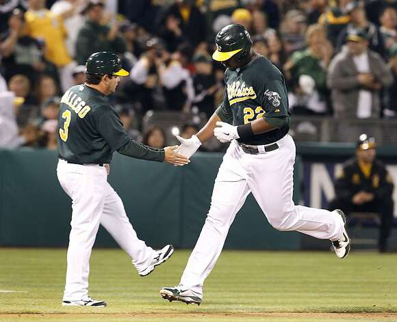 Oakland Athletics' Chris Carter (22) is congratulated by Oakland Athletics third base coach Mike Gallego (3) as he rounds third base after hitting a solo home run against the Boston Red Sox in the seventh inning of a baseball game Saturday,  Sept. 1, 2012 in Oakland, Calif.  Oakland won 7-1. (AP Photo/ Tony Avelar) Photo: Tony Avelar, Associated Press