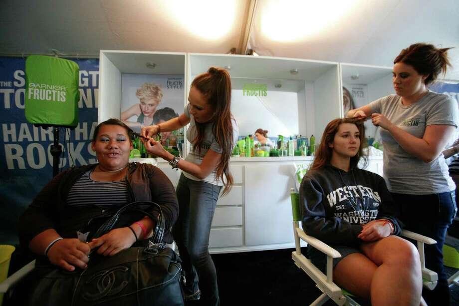 Women get their hair done at the Garnier Fructis Salon tent. Photo: Sofia Jaramillo / SEATTLEPI.COM