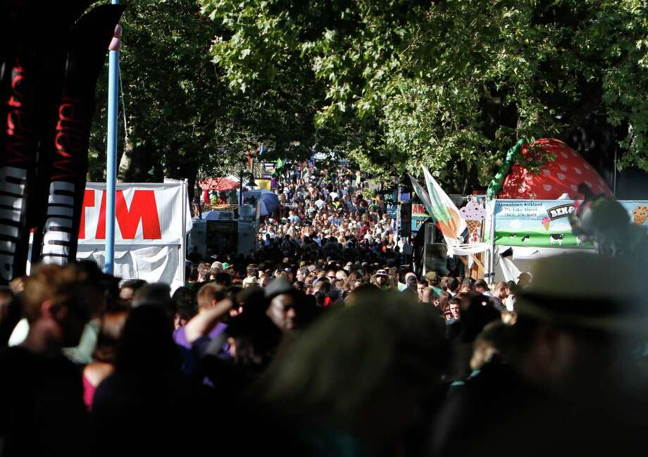 Hundreds of people crowd a walkway during Bumbershoot music festival at the Seattle Center on Saturday, Sept. 1, 2012. Photo: Sofia Jaramillo / SEATTLEPI.COM