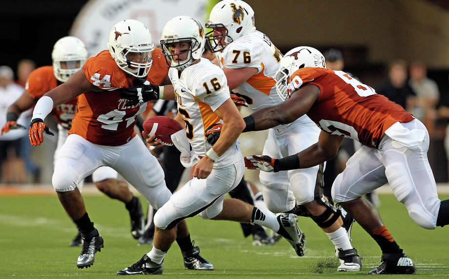 The Longhorn defense traps Brett Smith as Texas hosts Wyoming at D.K.Royal Stadium in Austin on September 1, 2012. Photo: Tom Reel, Express-News / ©2012 San Antono Express-News