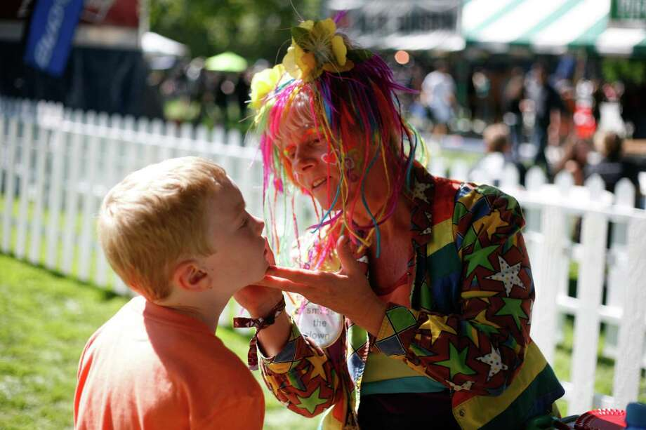 A boy gets his face painted. Photo: Sofia Jaramillo / SEATTLEPI.COM