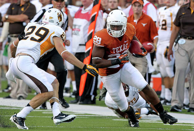Malcolm Brown turns back into the field after a long gain on the sideline as Texas hosts Wyoming at D.K.Royal Stadium in Austin on September 1, 2012. Photo: Tom Reel, Express-News / ©2012 San Antono Express-News