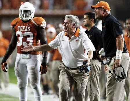 Mack Brown protests an unnecessary roughness call in the second half as Texas hosts Wyoming at D.K.Royal Stadium in Austin on September 1, 2012. Photo: Tom Reel, Express-News / ©2012 San Antono Express-News