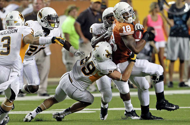 Longhorn tight end D.J. Grant scrambles the defense on the right with a reception in the second half as Texas hosts Wyoming at D.K.Royal Stadium in Austin on September 1, 2012. Photo: Tom Reel, Express-News / ©2012 San Antono Express-News