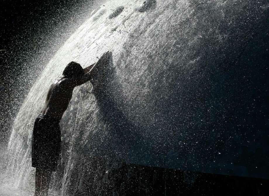 A boy plays in the fountain. Photo: Sofia Jaramillo / SEATTLEPI.COM