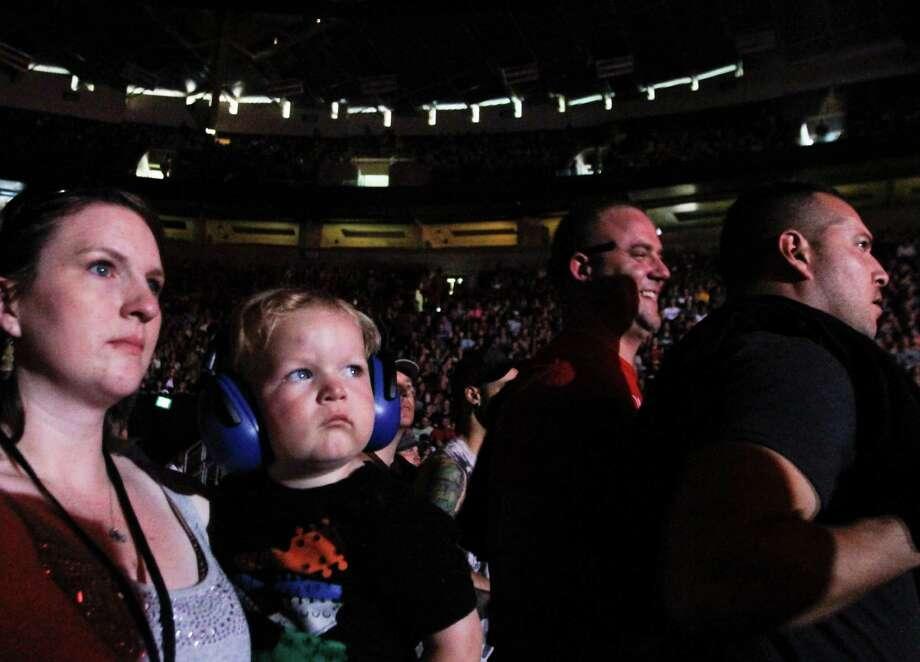 A baby wears ear protectors as Gotye performs. Photo: Sofia Jaramillo / SEATTLEPI.COM
