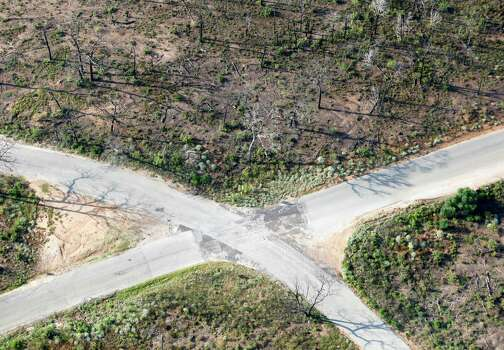 A road intersection seen by many in a widely distributed Sept. 6, 2011 aerial image is seen almost one year after the Bastrop Fire Complex fire in a second aerial image taken Monday Aug 20, 2012. Photo: William Luther, San Antonio Express-News / © 2012 San Antonio Express-News