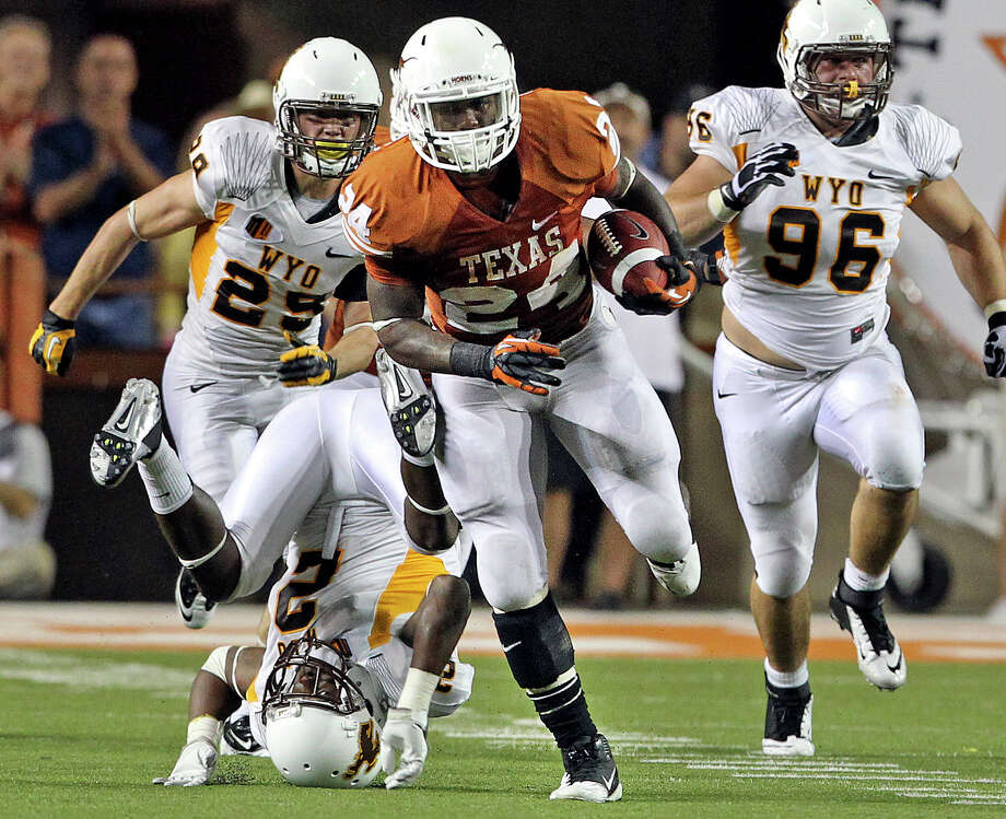 Longhorn running back Joe Bergeron breaks through on  64 yard rush from deep in his own territory as Texas hosts Wyoming at D.K.Royal Stadium in Austin on September 1, 2012. Photo: Tom Reel, Tom Reel/Express-News / ©2012 San Antono Express-News