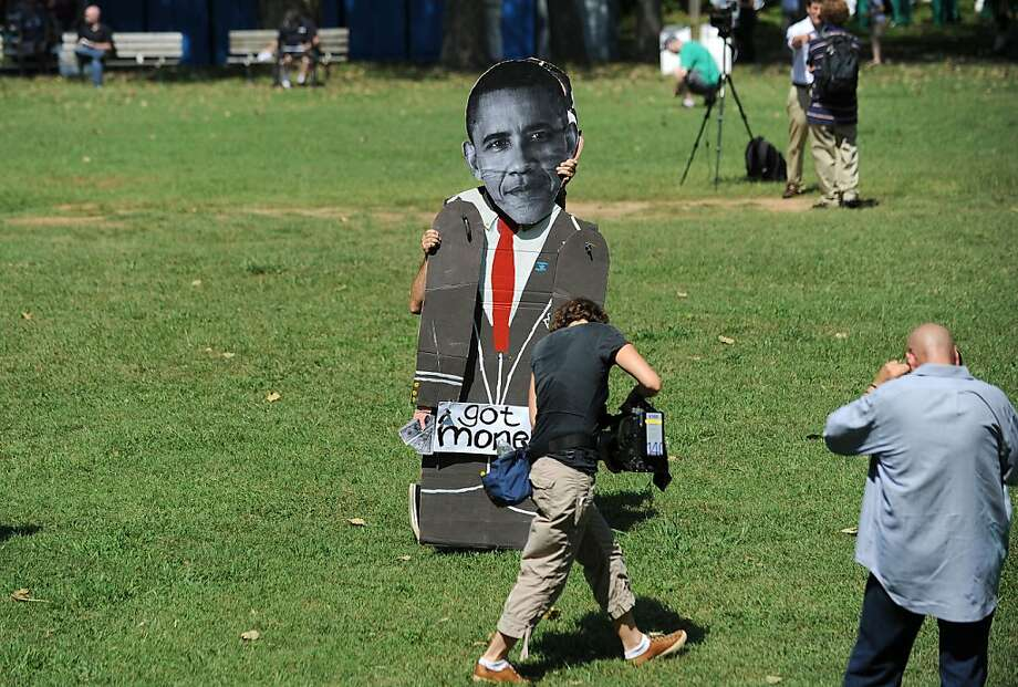 "A demonstrator carries a cardboard cut out likeness of President Barak Obama during the ""March On Wall Street South"" rally  in Charlotte, North Carolina ahead of the Democratic National Convention, September 2, 2012 in Charlotte, North Carolina.  Hundreds of people chanting slogans and carrying signs against and for an assortment of different causes marched Sunday through the city to protest what they said was seedy corporate influence on politics. AFP PHOTO / ROBYN BECKROBYN BECK/AFP/GettyImages Photo: Robyn Beck, AFP/Getty Images"