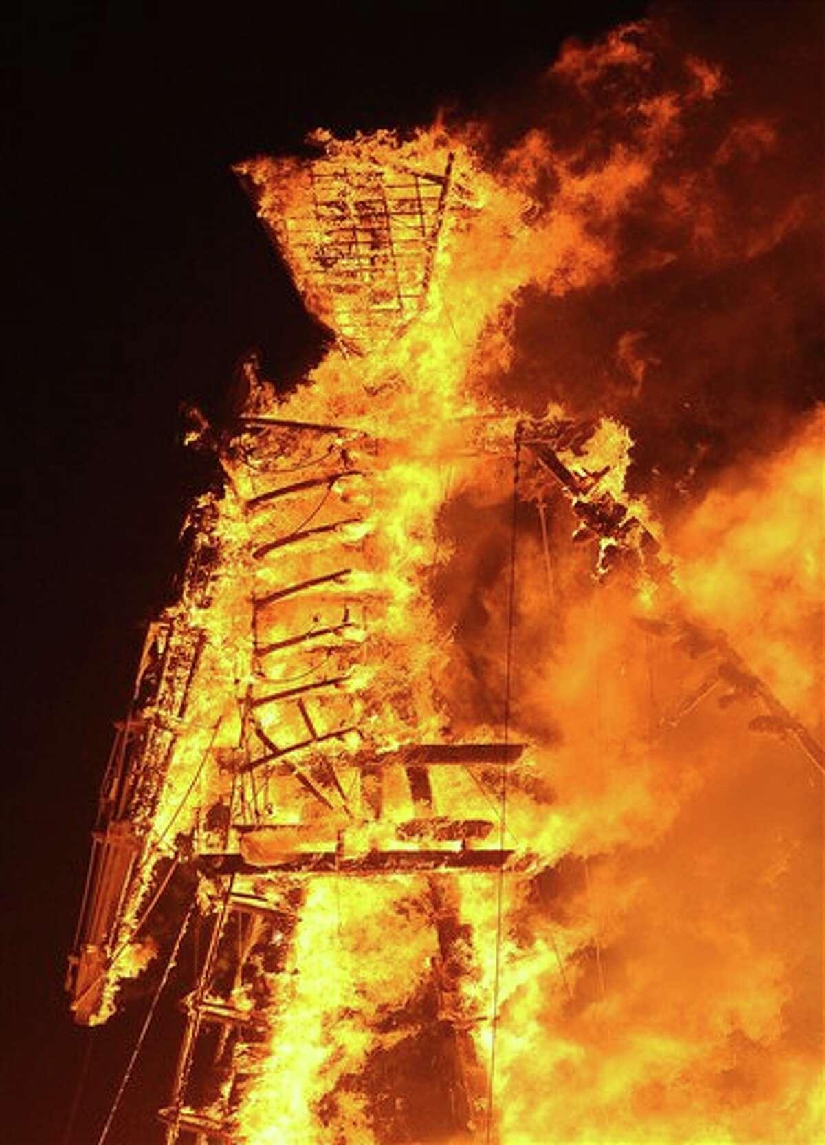 The Man burns on the playa at Burning Man on the Black Rock Desert near Gerlach, Nev. on Friday August 31, 2012.