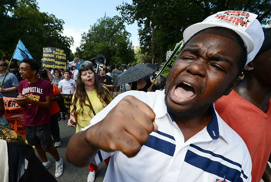 "Protestors shout slogans during the ""March On Wall Street South"" rally in Charlotte, North Carolina, ahead of the Democratic National Convention, on September 2, 2012. Hundreds of people chanting slogans and carrying signs against and for an assortment of different causes marched through the city to protest what they said was seedy corporate influence on politics.      AFP PHOTO / ROBYN BECKROBYN BECK/AFP/GettyImages Photo: Robyn Beck, AFP/Getty Images"