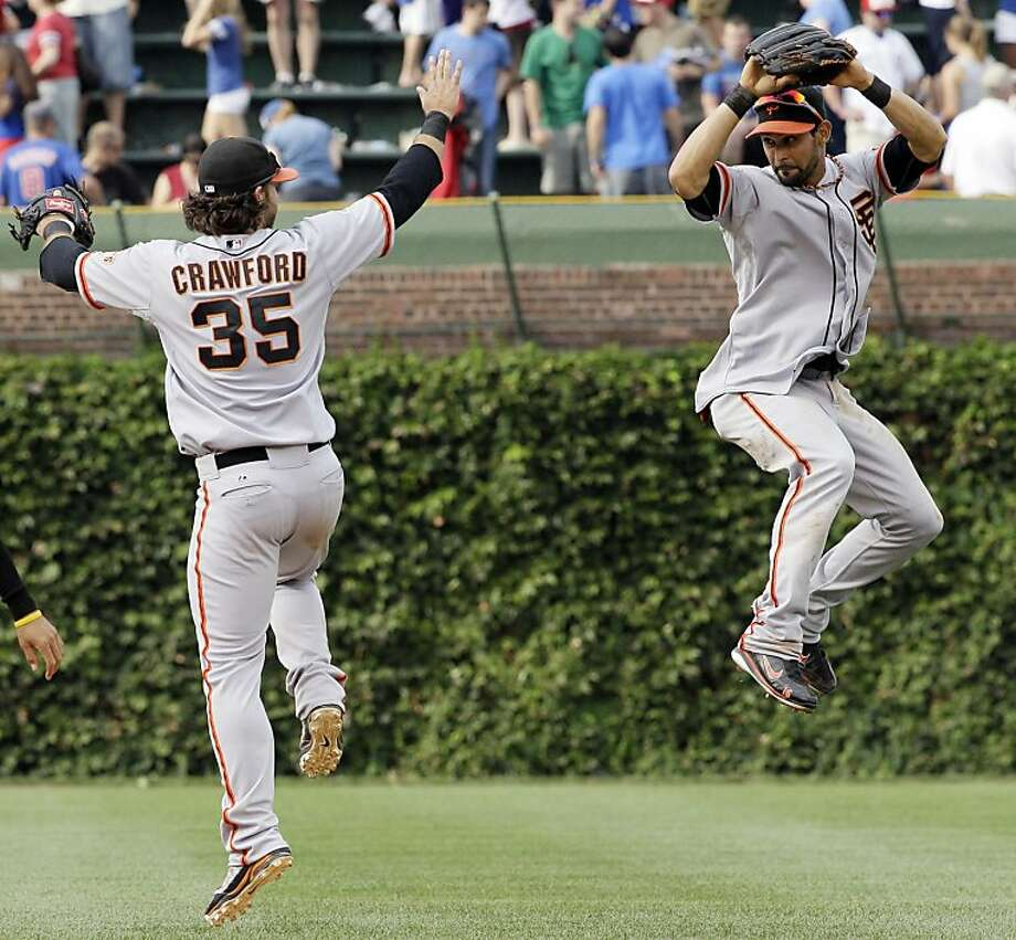 San Francisco Giants' Angel Pagan, right, celebrates with Brandon Crawford after the Giants defeated the Chicago Cubs 7-5 in a baseball game in Chicago, Sunday, Sept. 2, 2012. (AP Photo/Nam Y. Huh) Photo: Nam Y. Huh, Associated Press