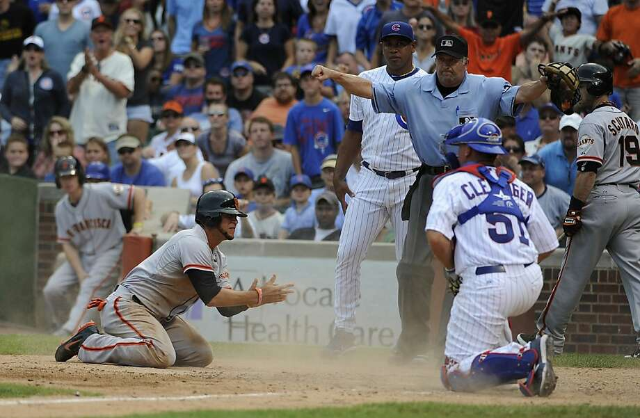 Gregor Blanco of the San Francisco Giants scores the go ahead run in the ninth inning as Steve Clevenger of the Chicago Cubs makes a late tag. The San Francisco Giants defeated the Chicago Cubs 7-5. Photo: David Banks, Getty Images
