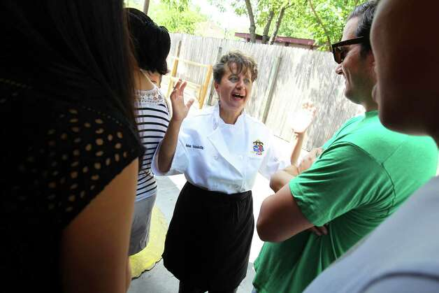 Owner Helen Velesiotis  speaks to customers waiting in line outside Taco Taco San Antonio on a busy Saturday morning September 1, 2012. (JENNIFER WHITNEY) Photo: JENNIFER WHITNEY, Special To The Express-News / © Jennifer Whitney